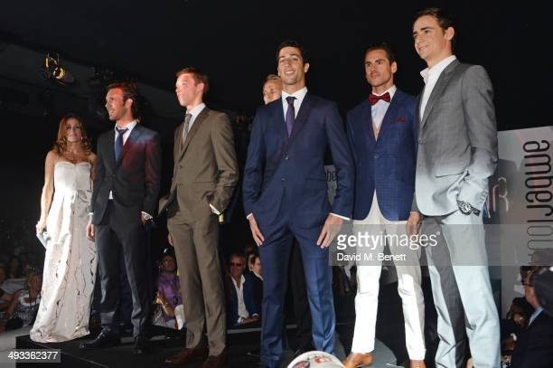 Natalie Pinkham and racing drivers JeanEric Vergne Daniil Kvyat Max Chilton Daniel Ricciardo Adrian Sutil and Esteban Gutierrez pose on the runway at...