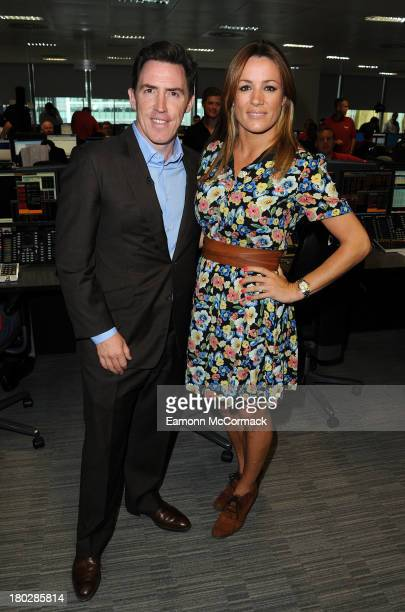 Natalie Pinkham and Rob Brydon attend the BGC Partners charity day at Canary Wharf on September 11 2013 in London England