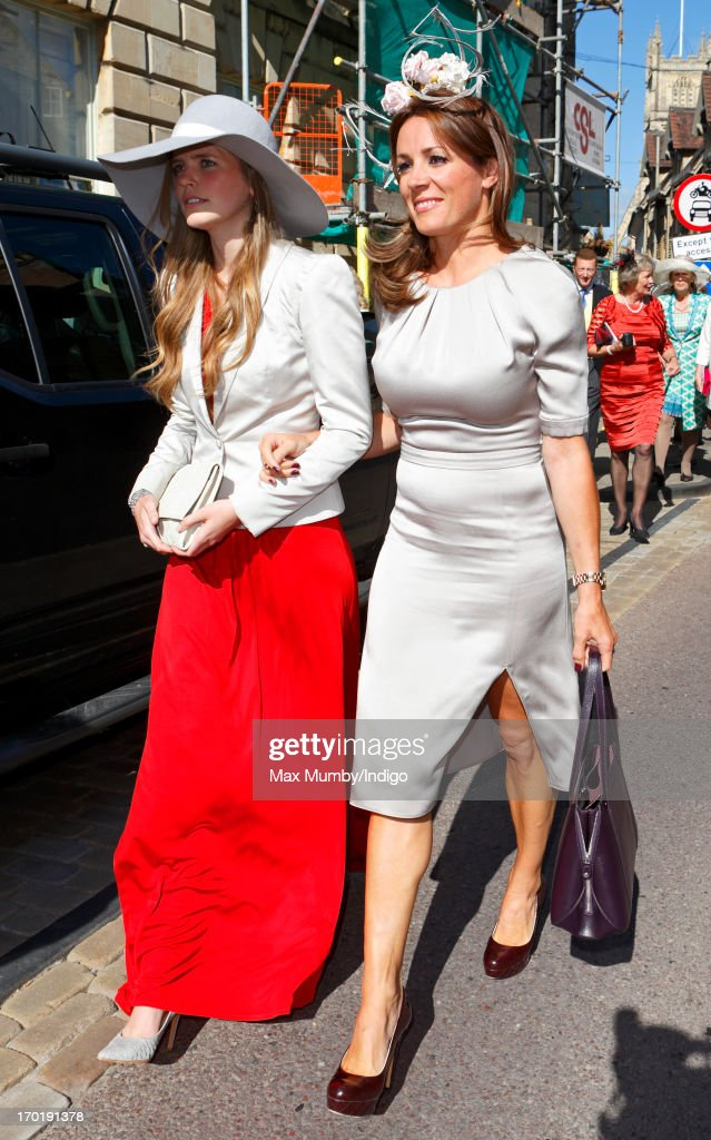 Natalie Pinkham (R) attends the wedding of Lady Natasha Rufus Isaacs and Rupert Finch at the church of St John the Baptist on June 8, 2013 in Cirencester, England.