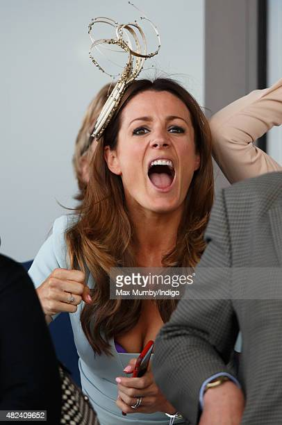 Natalie Pinkham cheers as she watches the racing on day three of the Qatar Goodwood Festival at Goodwood Racecourse on July 30 2015 in Chichester...