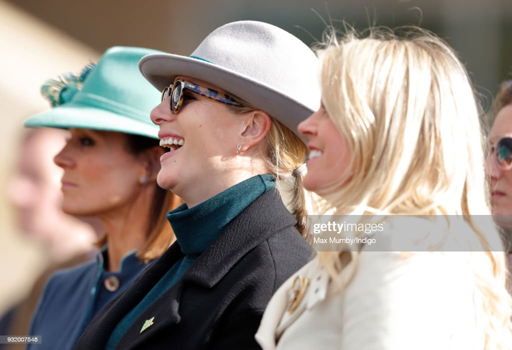 Natalie Pinkham, Zara Phillips and Chemmy Alcott watch the racing as they attend day 1 'Champion Day' of the Cheltenham Festival at Cheltenham Racecourse on March 13, 2018 in Cheltenham, England.