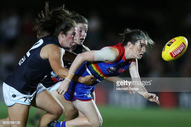 Natalie Plane of the Blues tackles Monique Conti of the Bulldogs during the round four AFLW match between the Western Bulldogs and the Carlton Blues...
