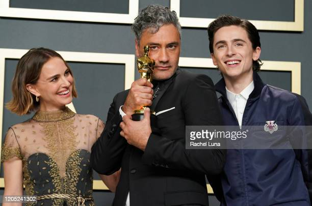 "Natalie Portman, Taika Waititi, winner of the Adapted Screenplay award for ""Jojo Rabbit,"" and Timothée Chalamet pose in the press room during 92nd..."