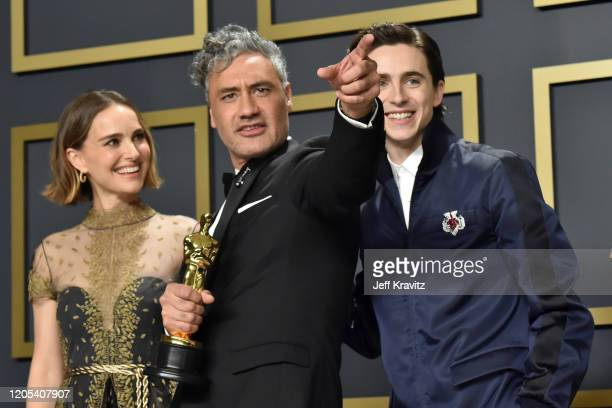 """Natalie Portman, Taika Waititi, winner of the Adapted Screenplay award for """"Jojo Rabbit,"""" and Timothée Chalamet pose in the press room during the..."""