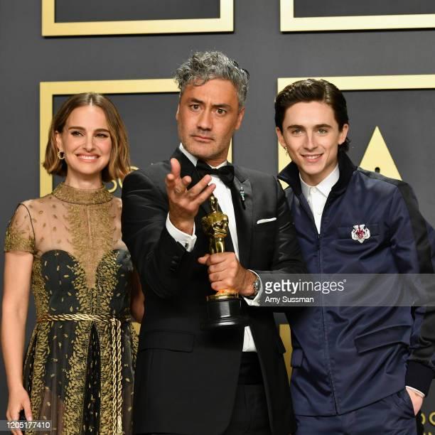 "Natalie Portman , Timothée Chalamet with Director Taika Waititi, winner of the Adapted Screenplay award for ""Jojo Rabbit,"" pose in the press room..."