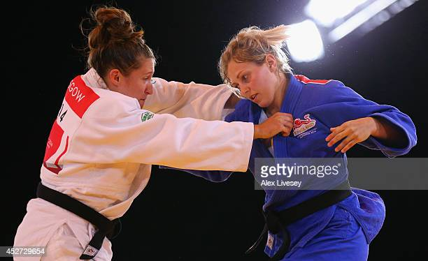 Natalie Powell of Wales on her way to victory over Gemma Gibbons of England in the Women's -78kg Judo gold medal final at the Scottish Exhibition and...