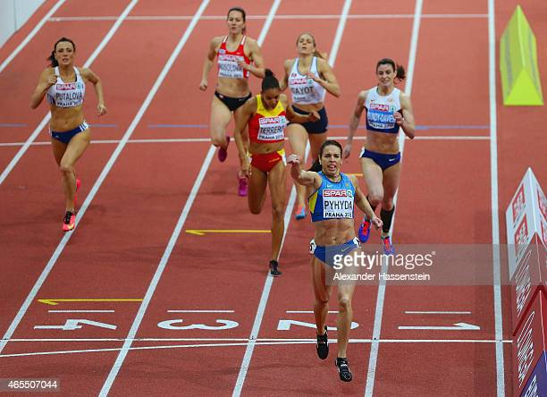 Natalie Pyhyda of Ukraine crosses the line to win gold in the Women's 400 metres Final during day two of the 2015 European Athletics Indoor...