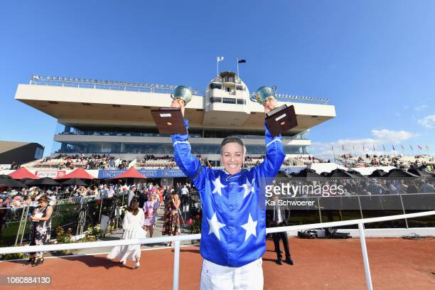 Natalie Rasmussen poses with the trophies for the best trainer and best driver after winning Race 10 Christchurch Casino NZ Trotting Cup during New...