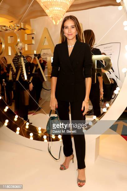 Natalie Salmon wearing Bvlgari attends the launch of the Bvlgari Cinemagia popup boutique at Harrods on October 10 2019 in London England