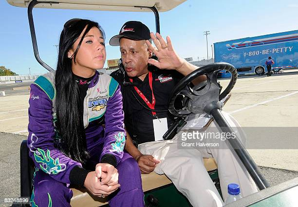 Natalie Sather talks with Wendell Scott during the NASCAR Drive for Diversity Combine at South Boston Speedway on October 13, 2008 in South Boston,...