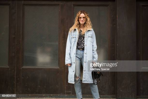 Natalie Scicolone is seen attending Ryan Roche during New York Fashion Week wearing a long denim jacket with torn blue jeans on February 11 2017 in...