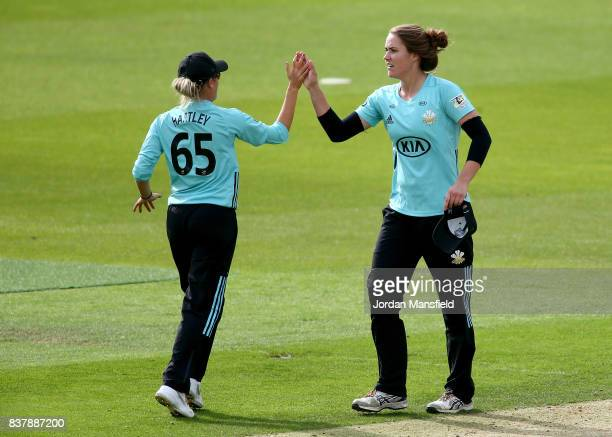 Natalie Sciver and Alex Hartley of Surrey celebrate victory during the Kia Super League match between Surrey Stars and Western Storm at The Kia Oval...