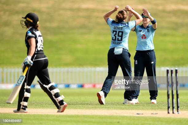 Natalie Sciver and Heather Knight of England celebrate the wicket of Hayley Jensen during game three of the One Day International series between New...
