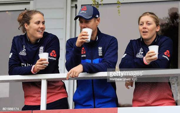 Natalie Sciver and Heather Knight of England look on as rain stops play during the ICC Women's World Cup 2017 match between England and Pakistan at...