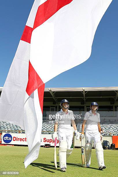 Natalie Sciver and Jennifer Gunn of England enter the field after tea during Day One of the Women's Ashes Test match between Australia and England at...
