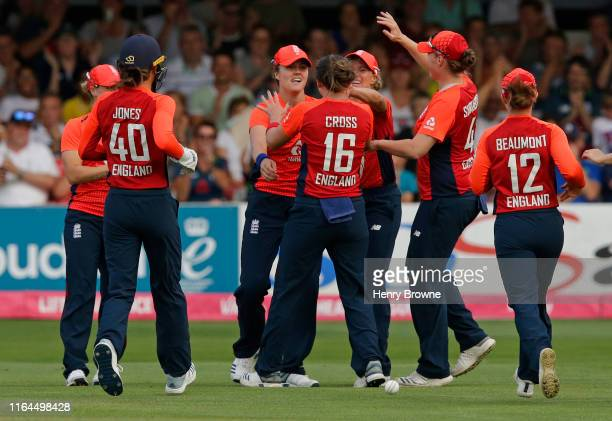 Natalie Sciver of England celebrates with team mates after catching out Alyssa Healy of Australia during the England v Australia 1st Vitality Women's...