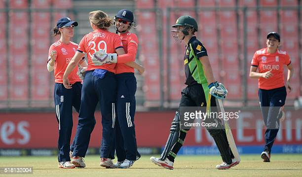 Natalie Sciver of England celebrates with teammates after dismissing Elyse Villani of Australia during the Women's ICC World Twenty20 India 2016 Semi...