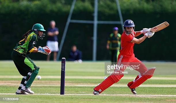 Natalie Sciver of England hits the ball towards the boundary as Syeda Nain Fatima Abidi of Pakistan looks on during the 1st NatWest Women's...