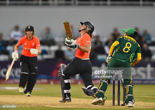 Natalie Sciver of England plays a shot as South Africa wicketkeeper Trisha Ghetty looks on of South Africa during the NatWest Women's International...