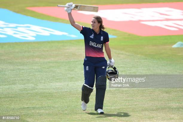 Natalie Sciver of England raises her bat after scoring one hundred runs during the ICC Women's World Cup 2017 between England and New Zealand at The...