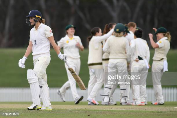 Natalie Sciver of England walks from the field after being dismissed by Sarah Aley of CAXI during day three of the Women's Tour match between England...
