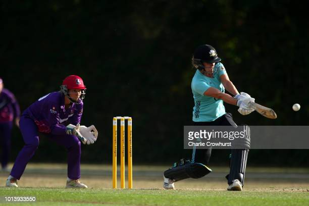 Natalie Sciver of Surrey stars hits out while wicket keeper Amy Jones of Loughborough Lightning looks on during the Kia Super League match between...