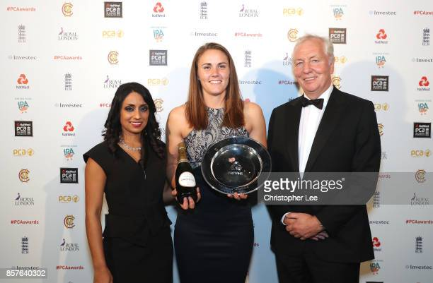 Natalie Sciver with her NatWest Womens Player of the Summer Award and presenters Isa Guha and David Wheldon during the NatWest PCA Awards at The...