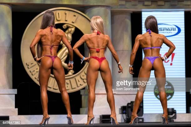 Natalie Sena Anastasia Barkhanova and Maria Solawa compete in Amateur Bikini B at the Arnold Amateur IFBB / NPC International Bodybuilding Fitness...