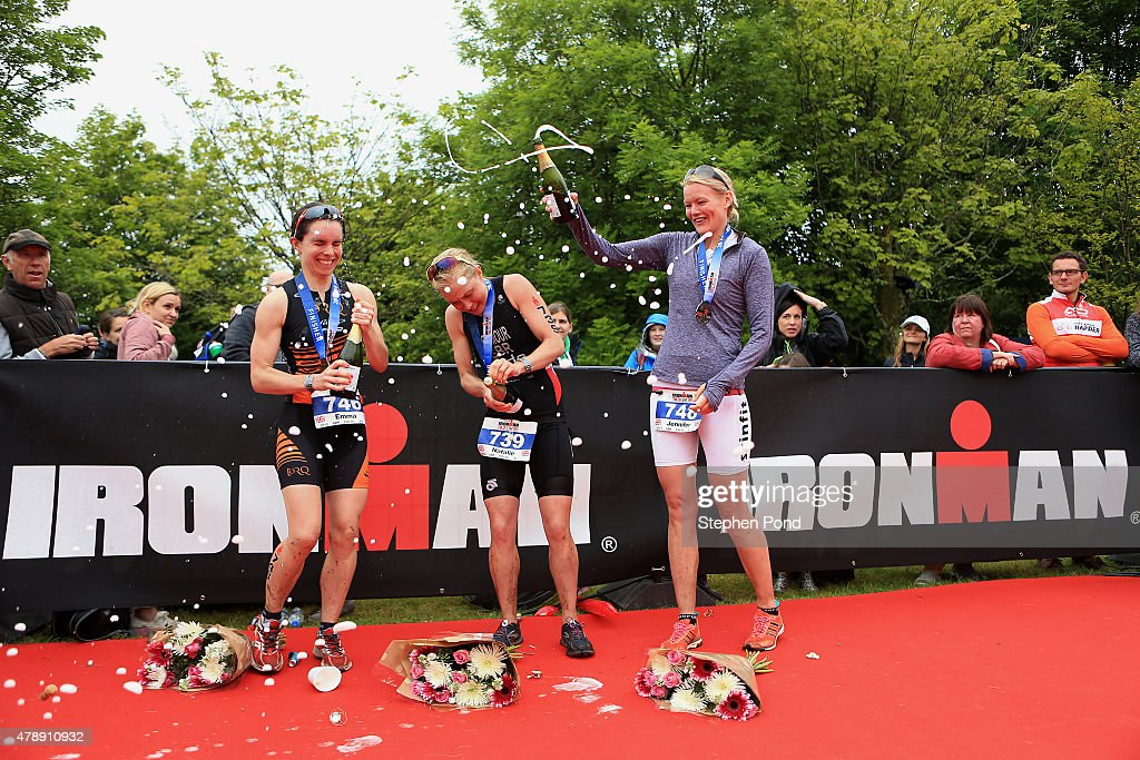 Natalie Seymour of Great Britain (centre) celebrates finishing as the first female alongside second place Jennifer Stewart of Great Britain (right) and Emma Lamont of Great Britain (left) in the Ironman 70.3 Exmoor event on June 28, 2015 in Exmoor National Park, England.