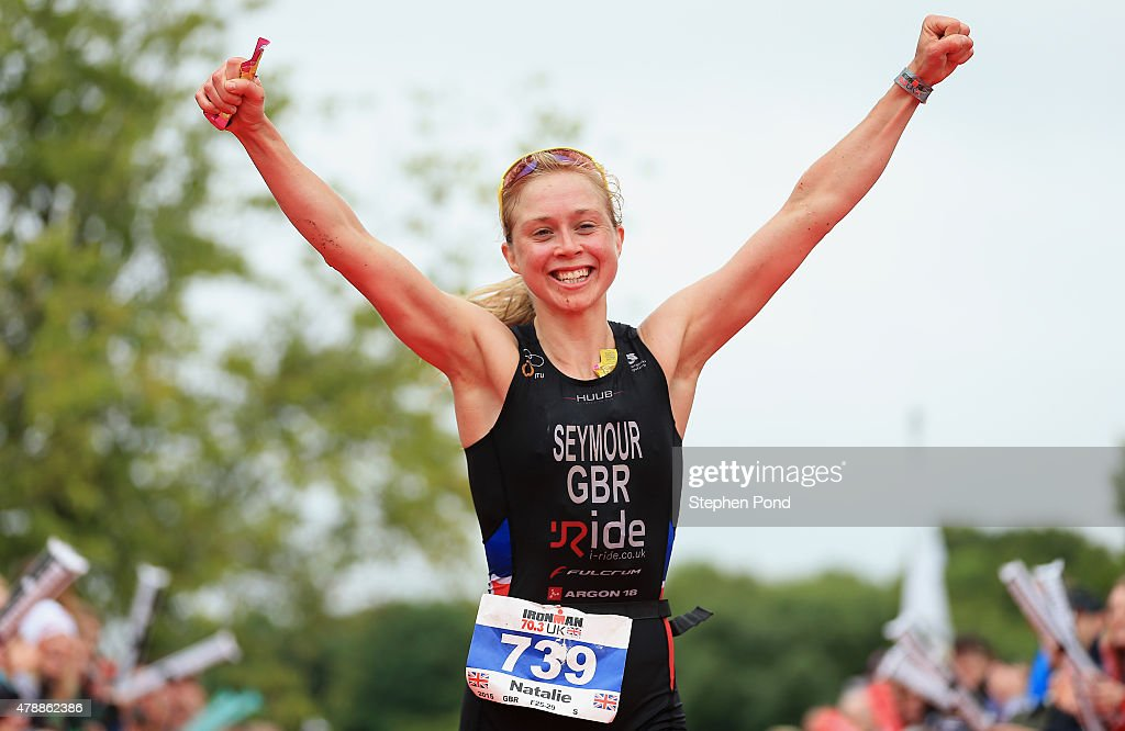 Natalie Seymour of Great Britain finishes as the first female in the Ironman 70.3 Exmoor event on June 28, 2015 in Exmoor National Park, England.