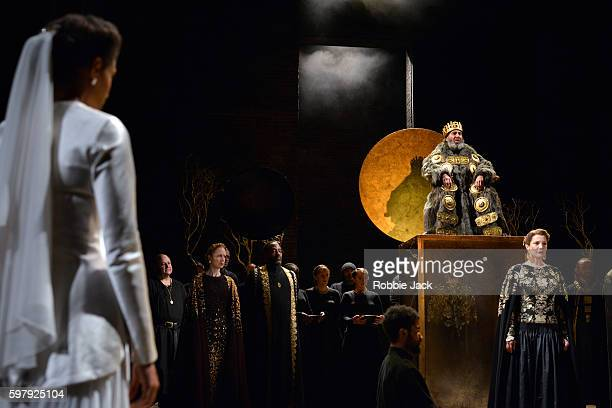 Natalie Simpson as Cordelia, Nia Gwynne as Goneril, Antony Sher as King Lear and Kelly Williams as Regan with artists of the company in William...