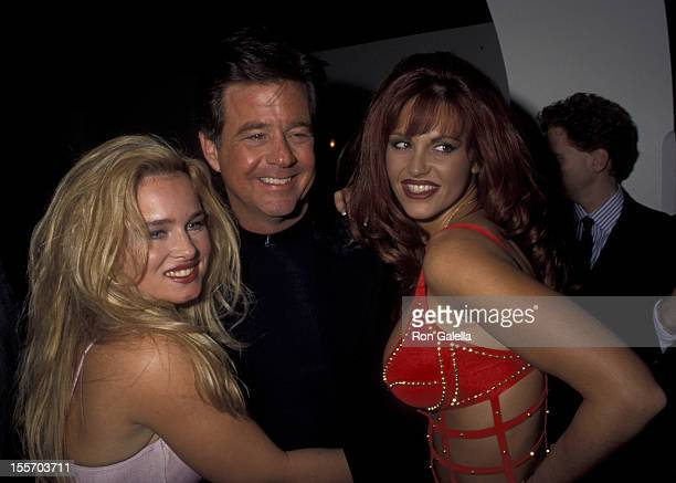 Natalie Smith Richard Bey and Gina Lamarca attends Penthouse Pets Swimsuit Pool Party on January 31 1995 at Bob Guccione's home in New York City