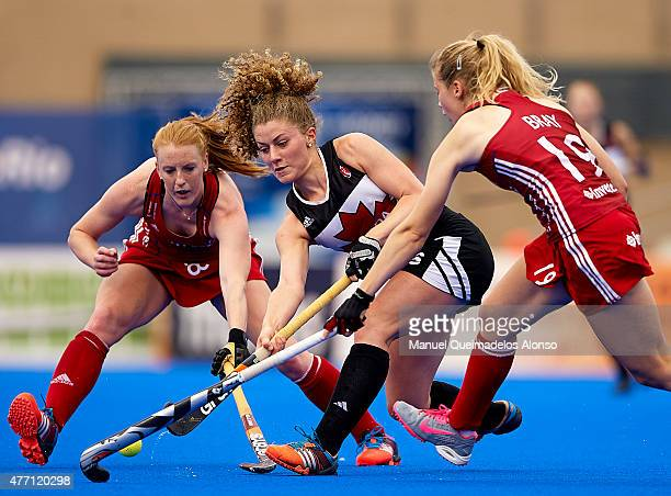 Natalie Sourisseau of Canada is tackled by Sophie Bray and Nic White of Great Britain during the match between Canada and Great Britain at...