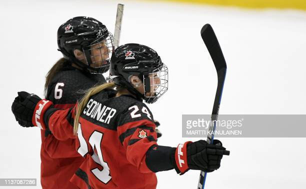 Natalie Spooner and Rebecca Johnston of Canada celebrate the 10 goal during the IIHF Women's Ice Hockey World Championships bronze medal match...