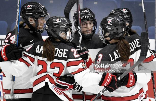 Natalie Spooner Erin Ambrose Blayre Turnbull Jocelyne Larocque and Sarah Nurse of Canada celebrate after Blayre Turnbull scores the team's first goal...