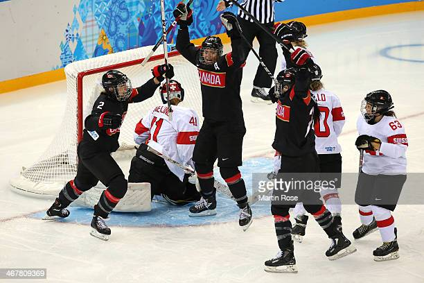 Natalie Spooner Hayley Wickenheiser and Meghan AgostaMarciano of Canada celebrate after Jocelyne Larocque of Canada scored a goal against Florence...