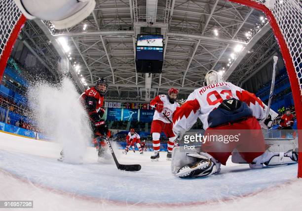 Natalie Spooner of Canada approaches Russian athlete Nadezhda Morozova during the Women's Ice Hockey Preliminary Round Group A game on day two of the...
