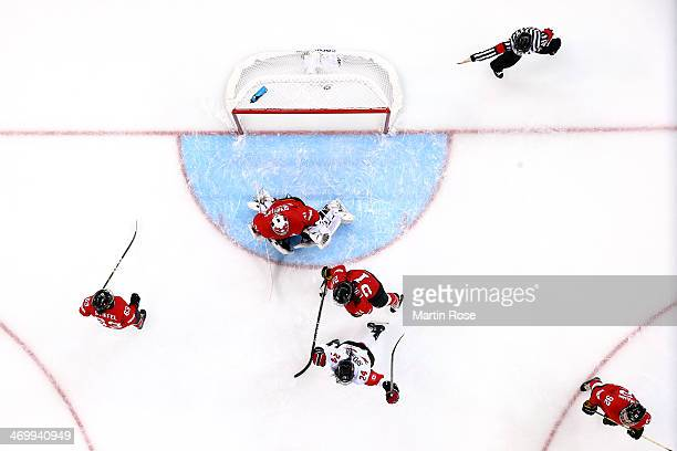 Natalie Spooner of Canada celebrates after scoring a goal against Florence Schelling of Switzerland in the first period during the Women's Ice Hockey...