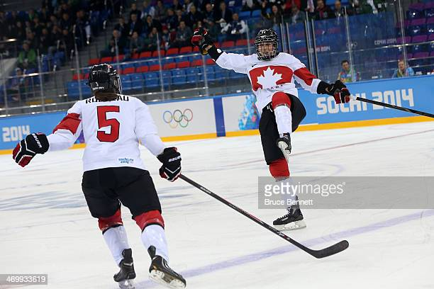 Natalie Spooner of Canada celebrates with teammate Lauriane Rougeau after scoring a goal against Switzerland in the first period during the Women's...