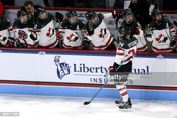 Natalie Spooner of Canada celebrates with teammates after scoring a goal against the the United States during the first period at Agganis Arena at...
