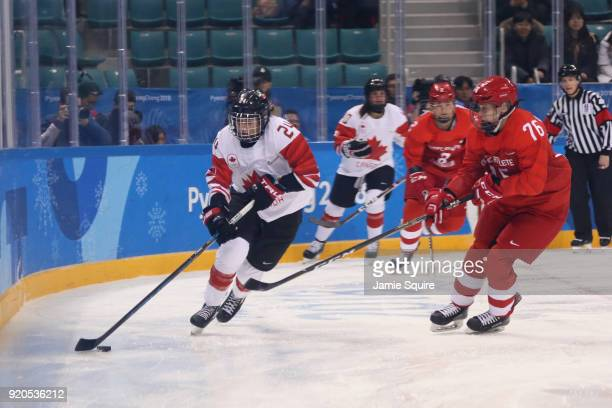 Natalie Spooner of Canada controls the puck against Yekaterina Nikolayeva of Olympic Athlete from Russia during the Ice Hockey Women Playoffs...