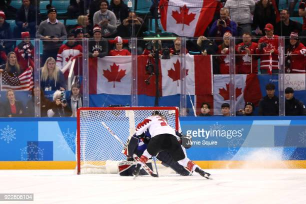 Natalie Spooner of Canada is unable to score a goal against Madeline Rooney of the United States in the overtime penaltyshot shootout during the...