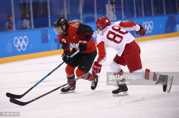 Natalie Spooner of Canada skates against Yekaterina Smolina of Olympic Athlete from Russia in the first period during the Women's Ice Hockey...