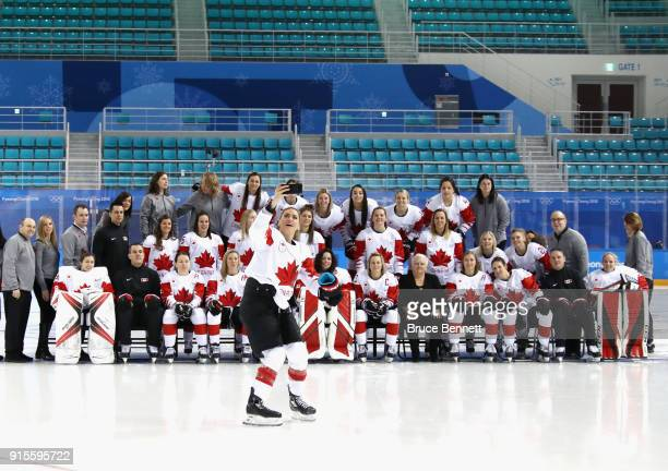 Natalie Spooner of Team Canada takes a cell phone photo of the team ahead of the PyeongChang 2018 Winter Olympic Games at the Kwandong Hockey Centre...