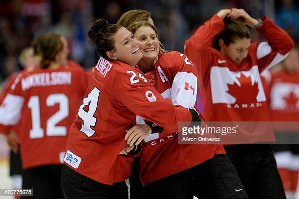 Natalie Spooner of the Canada and Hayley Wickenheiser hug after the overtime period of Canada's 32 gold medal ice hockey win over the USA Sochi 2014...
