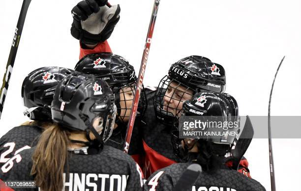 Natalie Spooner Rebecca Johnston Sarah Nurse Renata Fast and Brigitte Lacquette of Canada celebrate the 10 goal by Spooner during the IIHF Women's...
