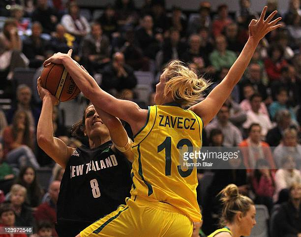 Natalie Taylor of New Zealand has a shot blocked by Hanna Zavecz of Australia during the first match between the Australian Opals and the New Zealand...