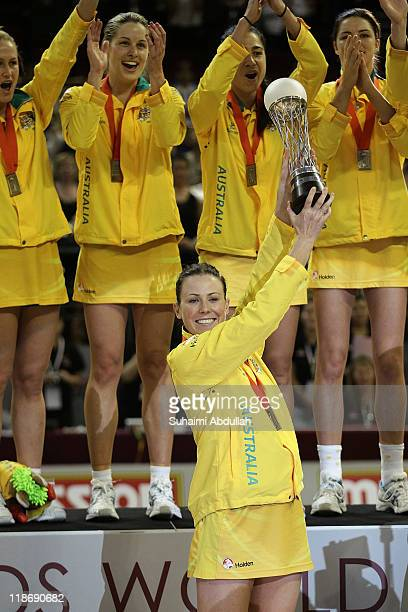 Natalie Von Bertouch of Australia lifts the championship trophy for the 2011 World Netball Championships at Singapore Indoor Stadium on July 10, 2011...