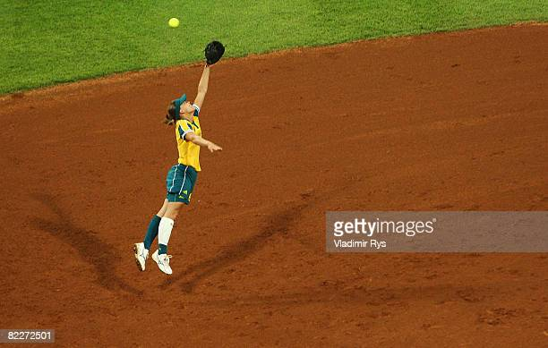 Natalie Ward of Australia leaps for a linedrive against Japan during their preliminary softball game at the Fengtai Sports Center Softball Field...