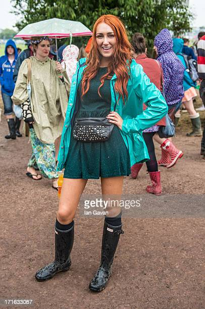 Natalie wears Top Shop Matalan and Hunter boots during the 2013 Glastonbury Festival on June 27 2013 in Glastonbury United Kingdom